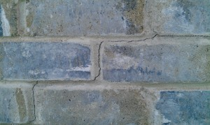 A crack between bricks is one tell-tale sign of foundation problems in Texas.