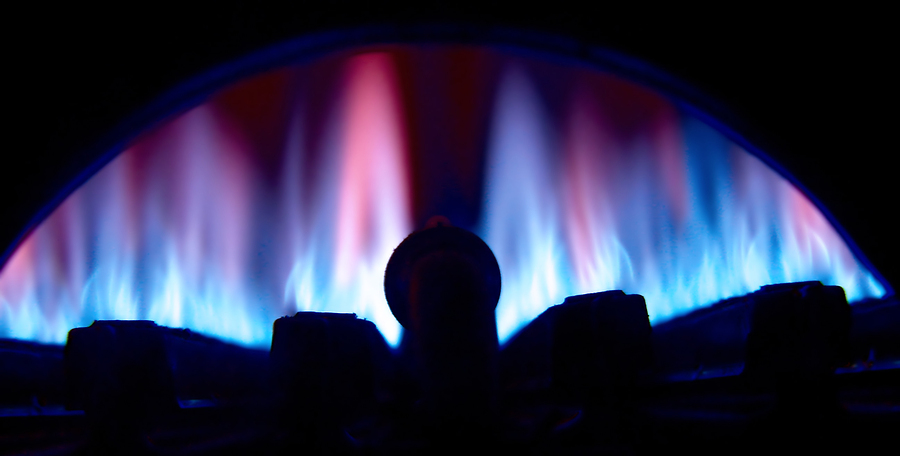 The lit burner on a gas water heater.